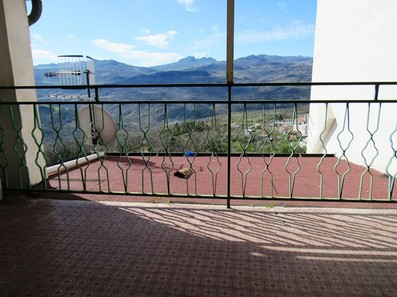 Mountain apartment with spacious terrace in a character full active town